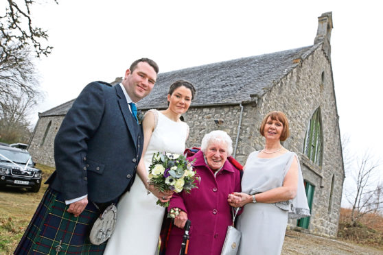 From left: Michael Strachan and Michelle Macdonald, who got married on Saturday, Michelle's grandmother Sadie, and mum Catherine.