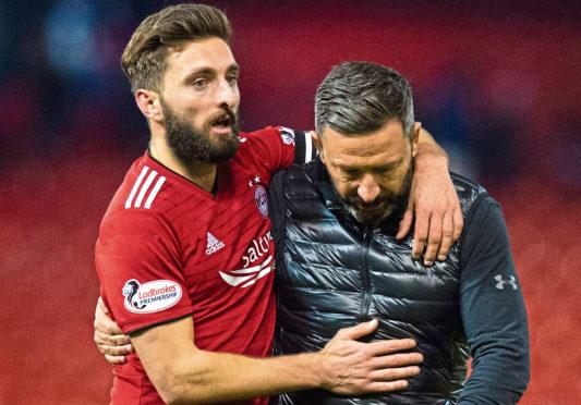 Aberdeen captain Graeme Shinnie celebrates with manager Derek McInnes at full time.