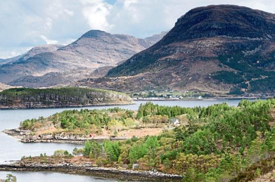 The highlands village of Shieldaig sits below Ben Shieldaig overlooking its Loch and island