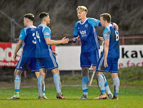 Peterhead's Russell Mclean celebrates  his goal with Cameron Eadie and Scott Brown