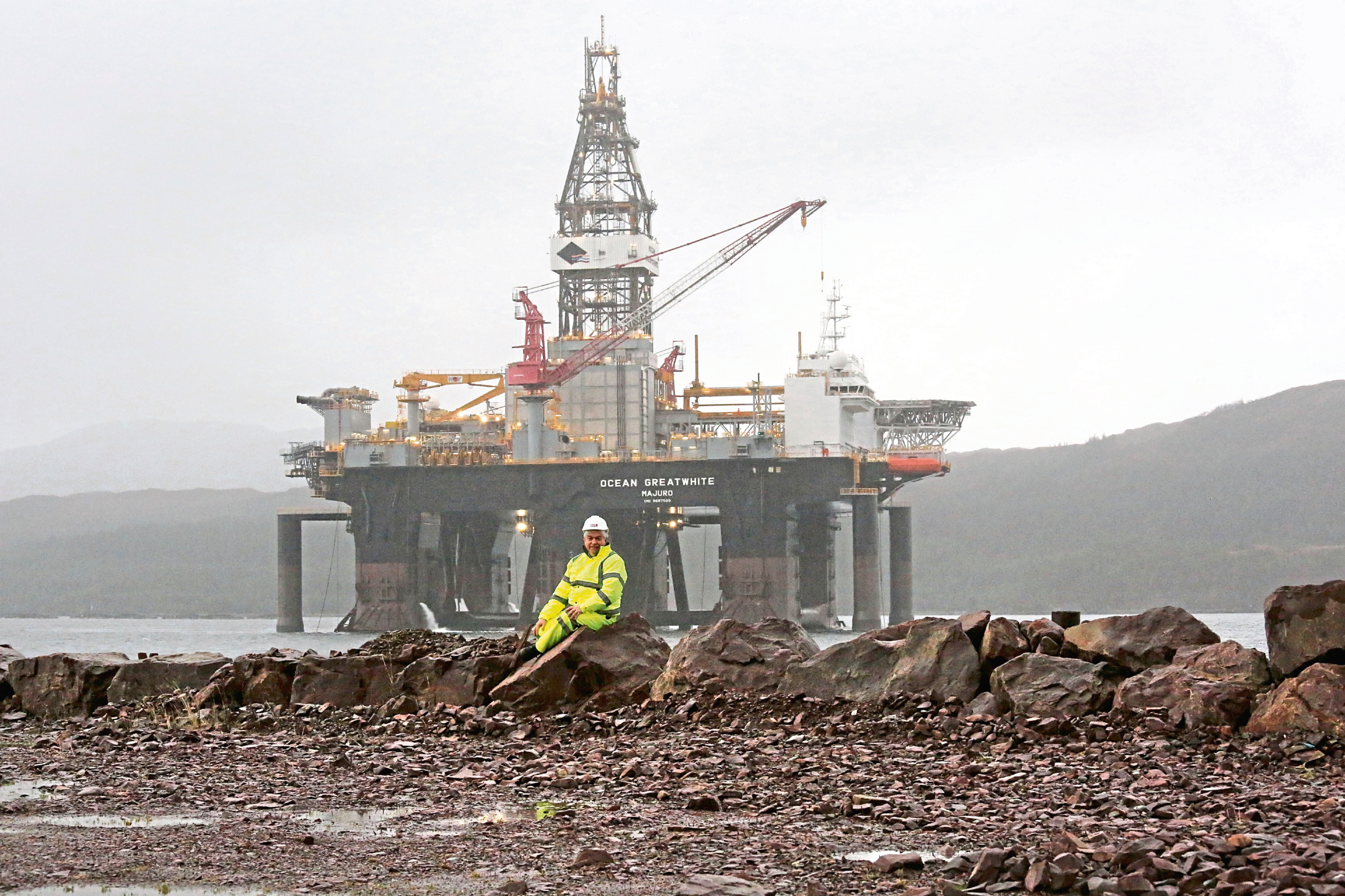 Kishorn Port LTD director Simon Russell with the Ocean Greatwhite oil rig which is the first rig to use the Kishorn port....pic Peter Jolly