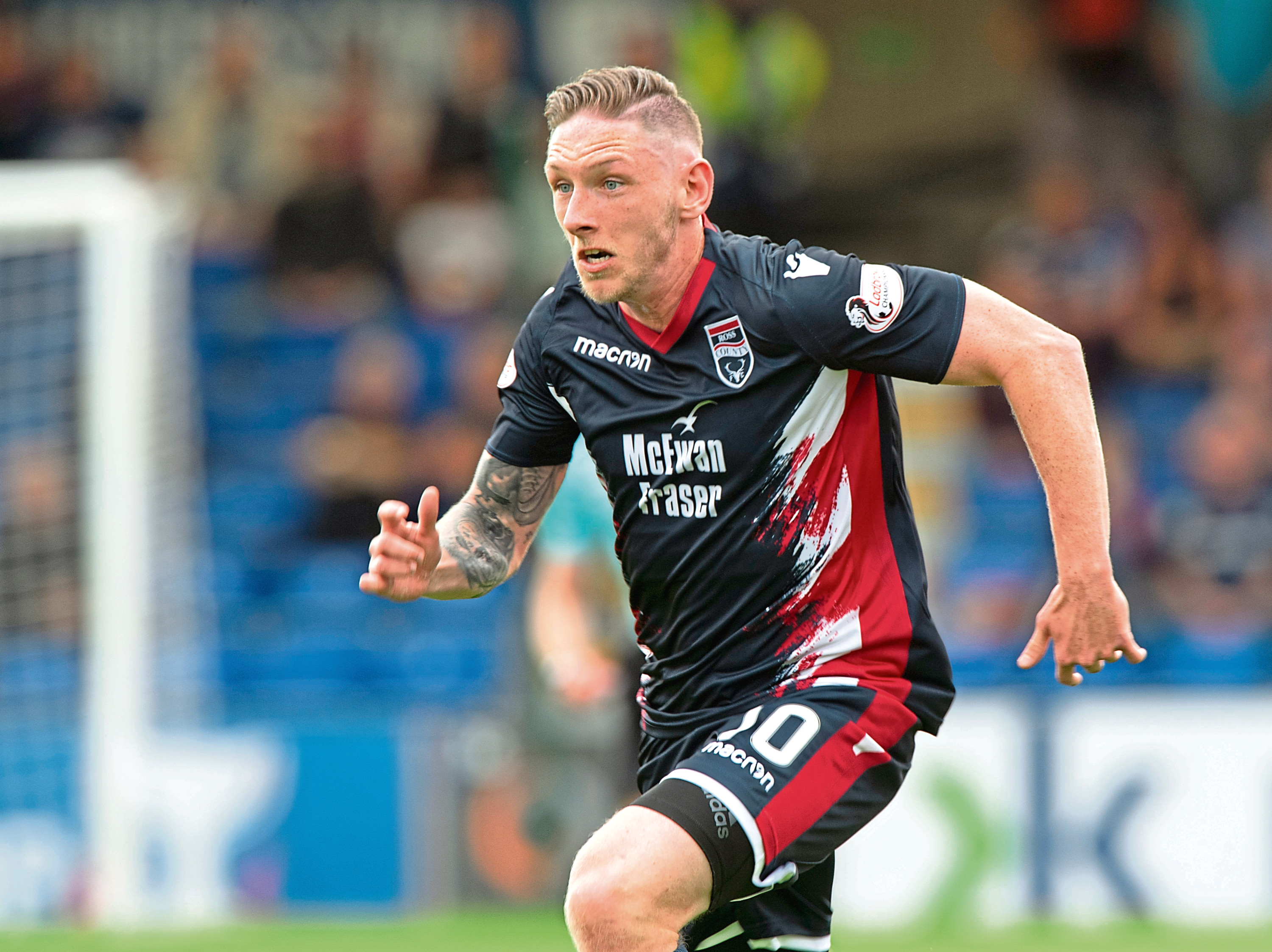Declan McManus in action for Ross County.