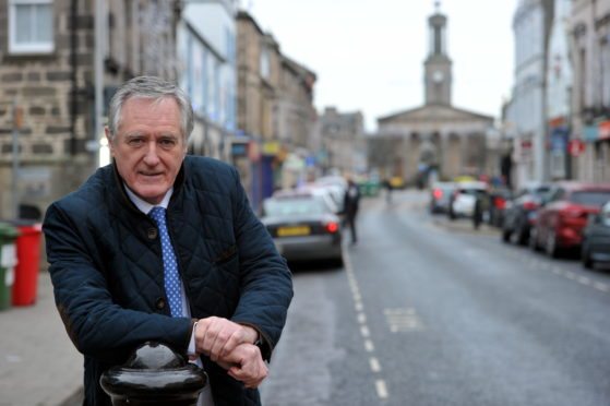 Councillor John Cowe in the High Street, Elgin.