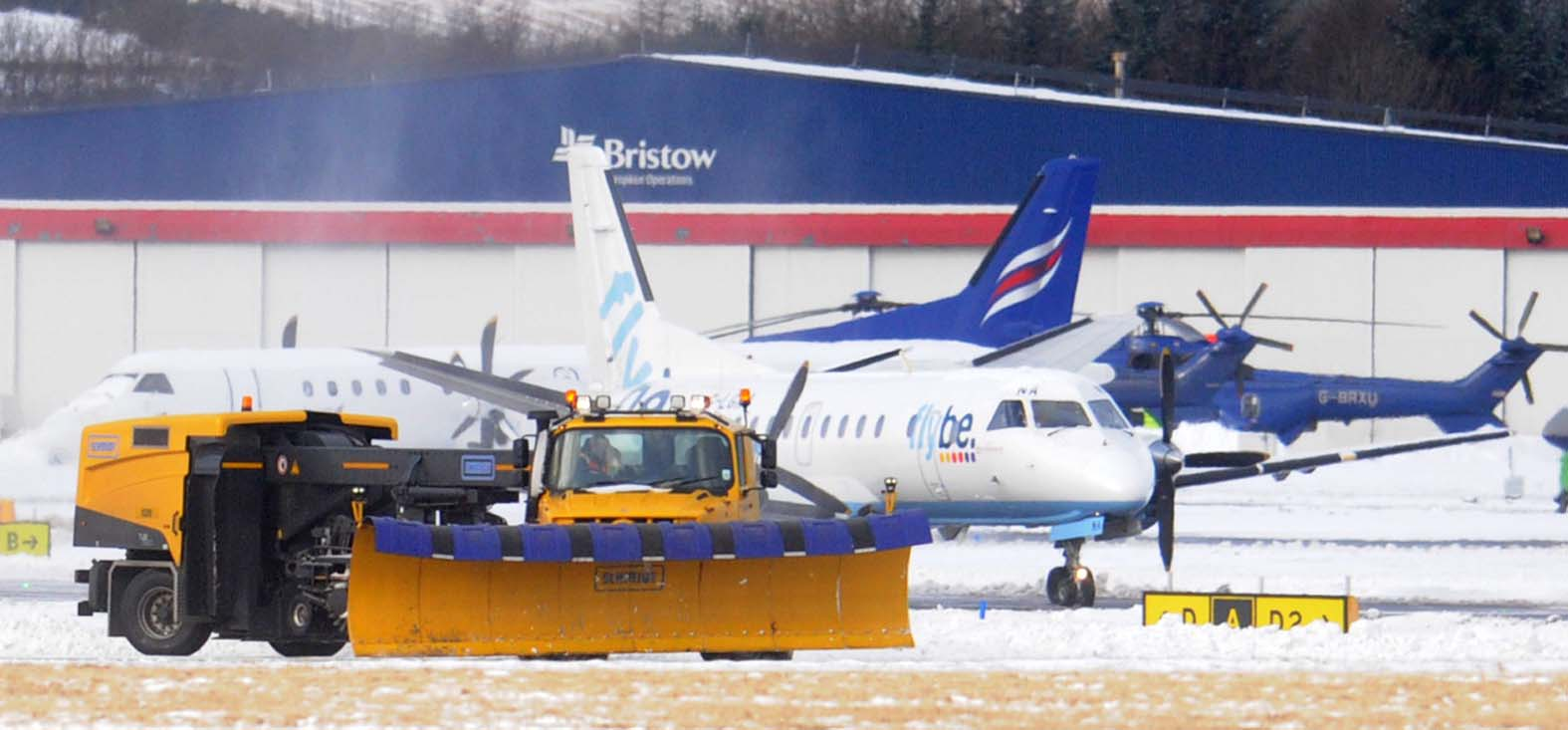 Snow clearing equipment in use at Aberdeen International Airport