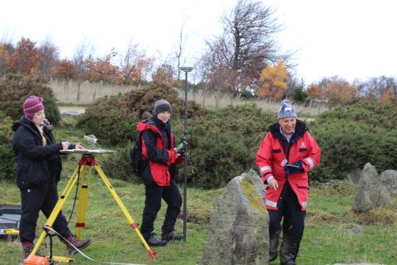 Archaeologists examining the stone circle.