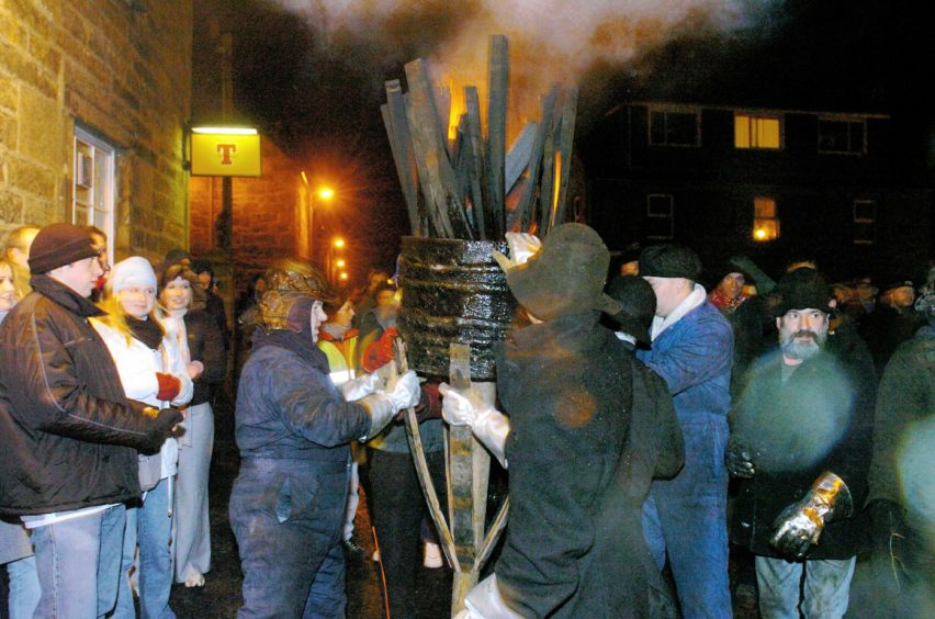 Photography by Sandy McCook, 'The Press and Journal' Inverness  The burning Clavie is carried through the streets of Burghead on Saturday evening.   See story. Date taken:10th Jan '04   .