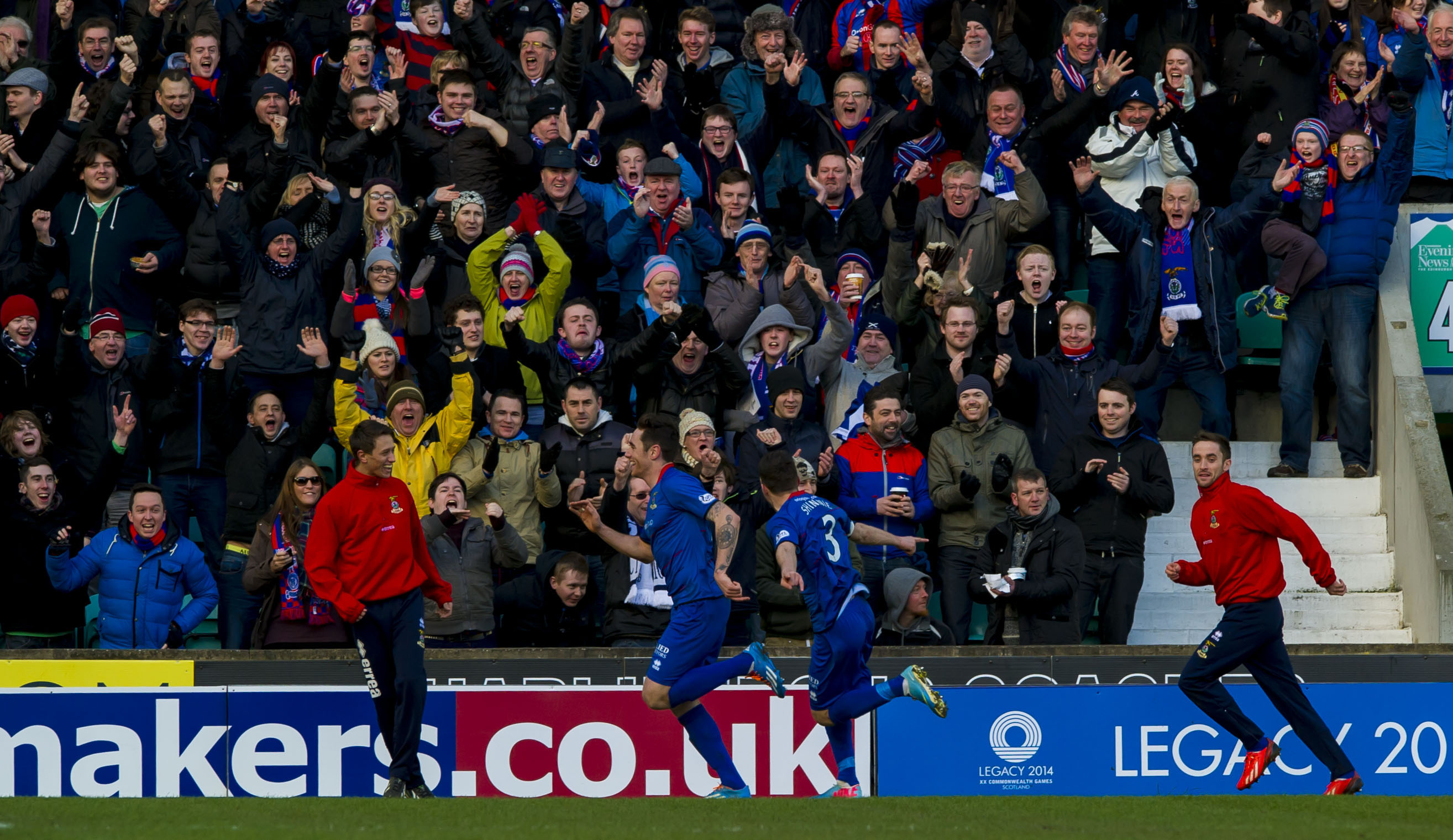 Greg Tansey celebrates in front of the Inverness supporters.
