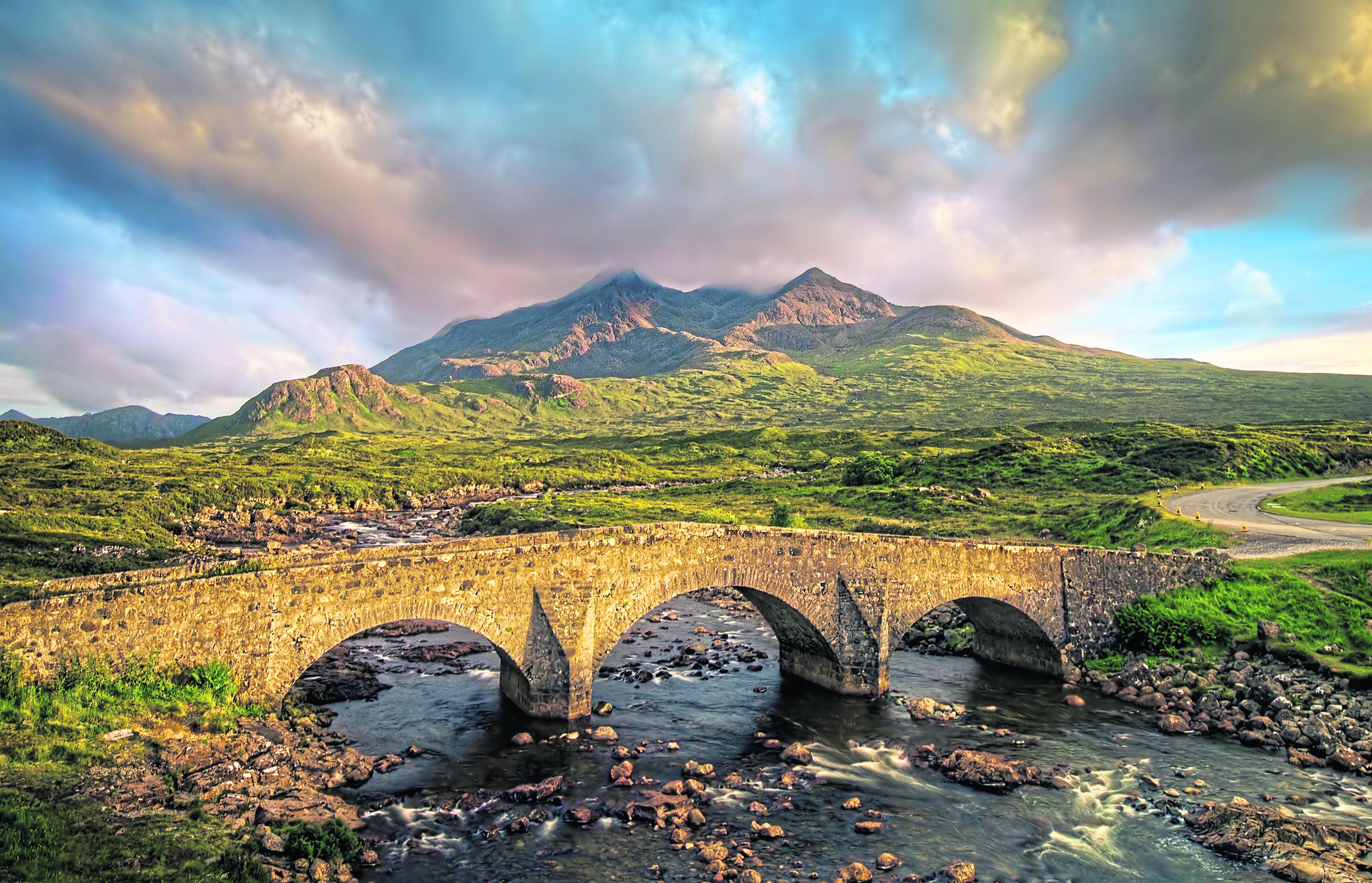 Sligachan Bridge and cloudy Black Cuillins in sunset light, Isle of Skye.