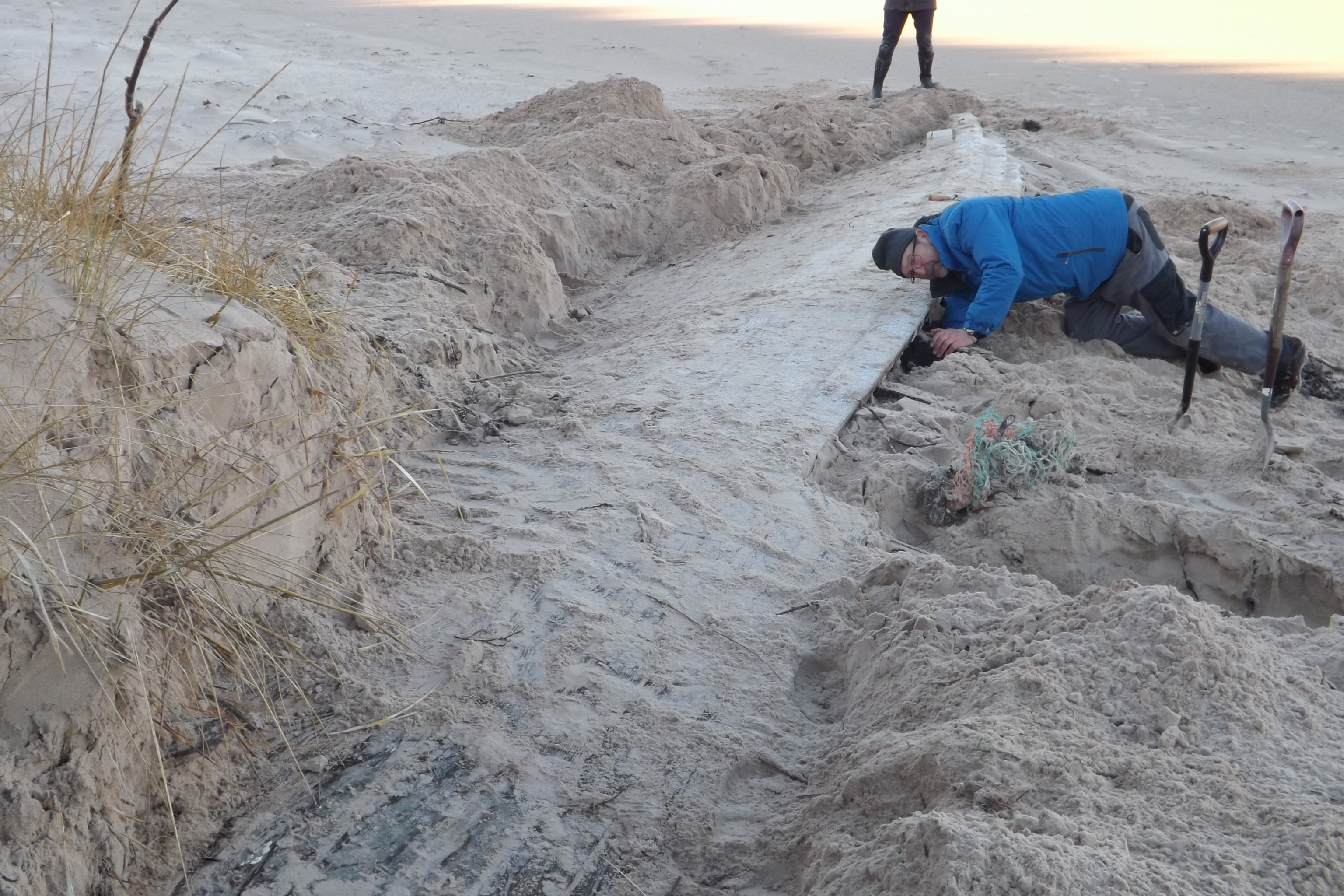 Members of Nairn Sailing Club turned out to help dig the mysterious vessel out from beneath the sand dune.