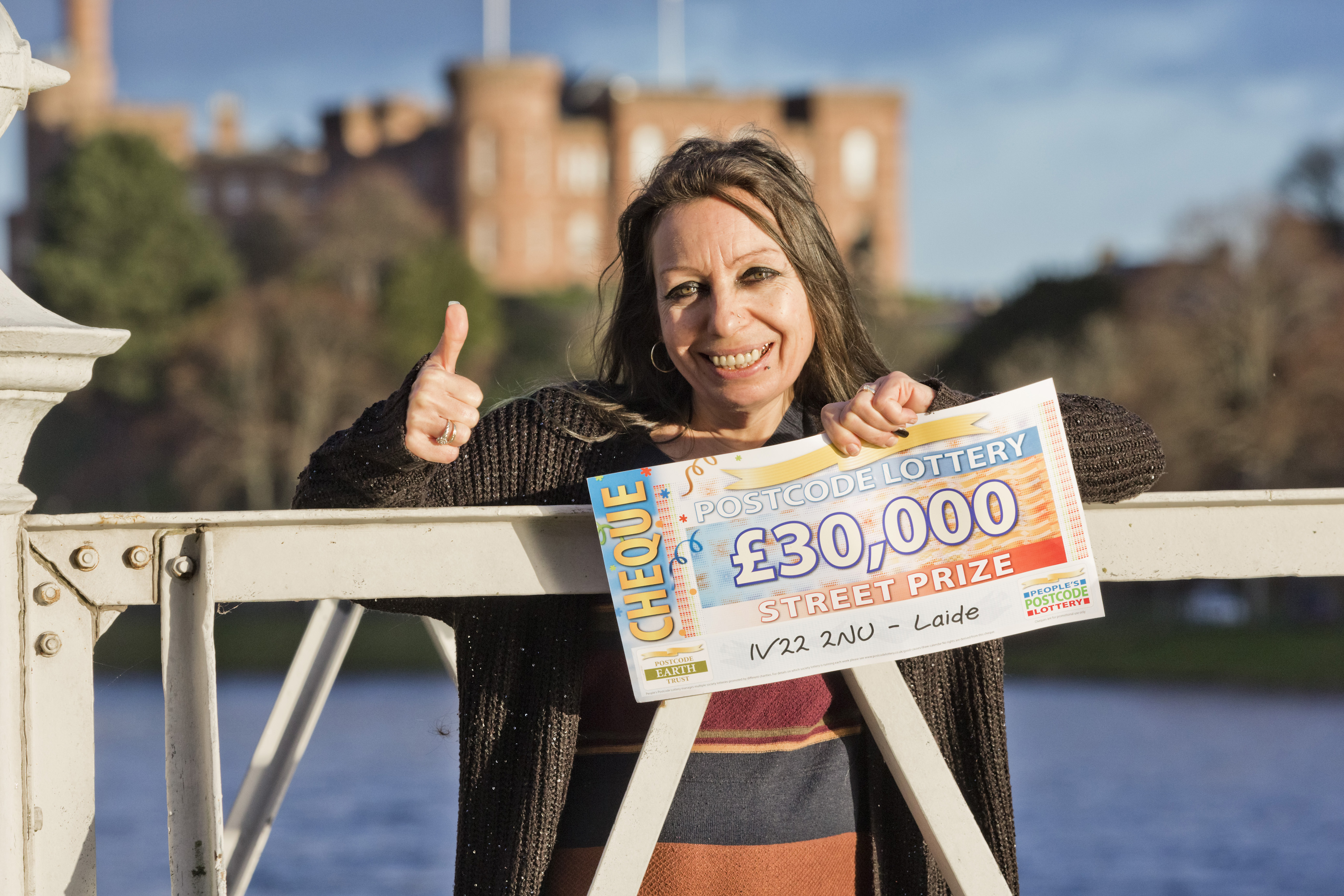 Daniele Martin with her cheque