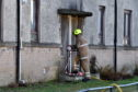 Scottish Fire and Rescue Service at the scene of a house fire on Mastrick Road, Aberdeen.