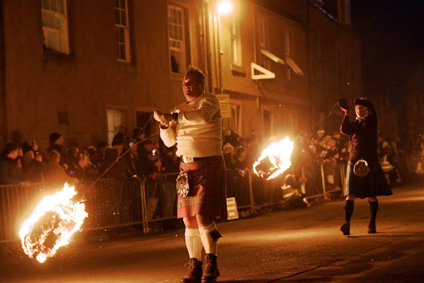 Stonehaven Hogmanay. Fireball festival on Stonehaven High Street. 01/01/19 Picture by KATH FLANNERY