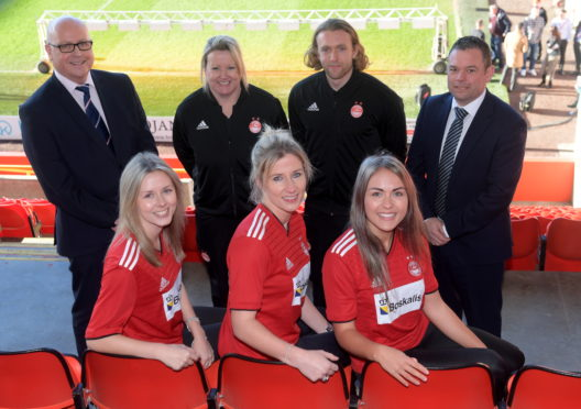 AFC Women's team players, from left, Loren Campbell, Kelly Forrest and Natasha Bruce. Back, Sponsor Tim Sheehan, Managers Emma Hunter and Harley Hamdani, with sponsor Stuart Cameron.