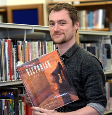 Aberdeen Central Library. A book has mysteriously been returned to the library after being posted 871 miles from Poland. Dallas King is pictured with the book. 22/01/19 Picture by KATH FLANNERY