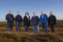 Sandie Maciver of Sandie Photos  Representatives from the crofting townships who have made a windfarm application. From left to right: Angus Campbell from Melbost and Branahuie, Donnie MacDonald from Aignish, Rhoda Mackenzie from Sandwick North Street and Murdo Macleod, Calum Buchanan and Kenny Morrison, all from Sandwick East Street and Lower Sandwick.