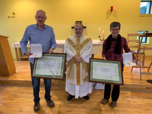 Ewen MacDonald,  Father Domenico Zanre of St Columba's R.C Church in Culloden and Helen MacGilp with their  Benemerenti papal awards, awarded by Pope Francis.