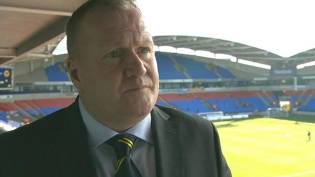 Scotland star, John McGinlay, has been banned by Bolton for criticising the chairman.