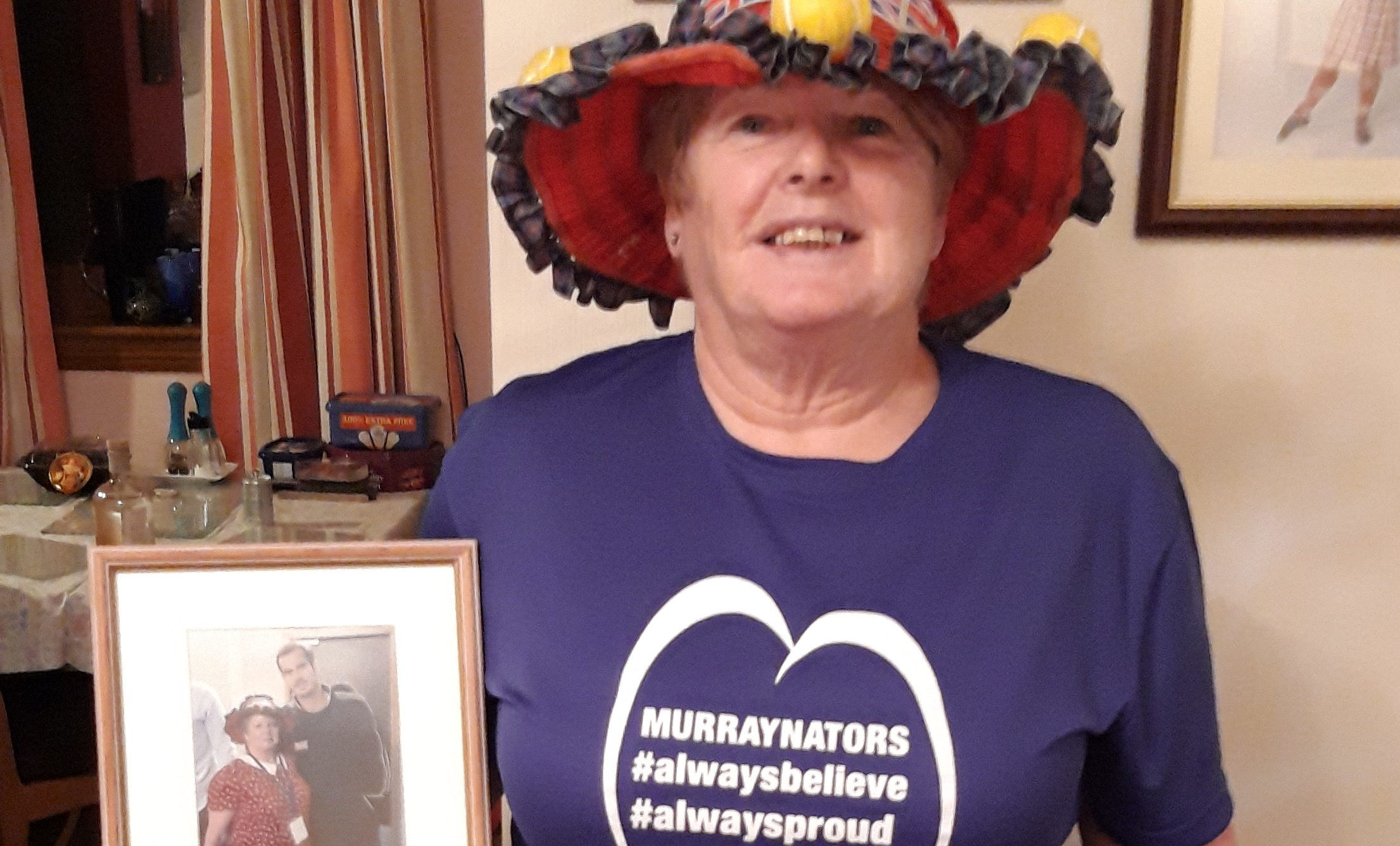 Joan MacGillivray holding the picture taken of her and Sir Andy Murray at the Davis Cup in 2015.