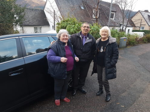 Kidney dialysis patients Jean MacIntosh and Brenda Hamilton with their taxi driver