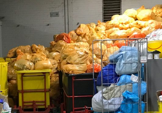Piles of clinical waste spanning around 12 foot in height which NHS Highland porters have been forced to deal with