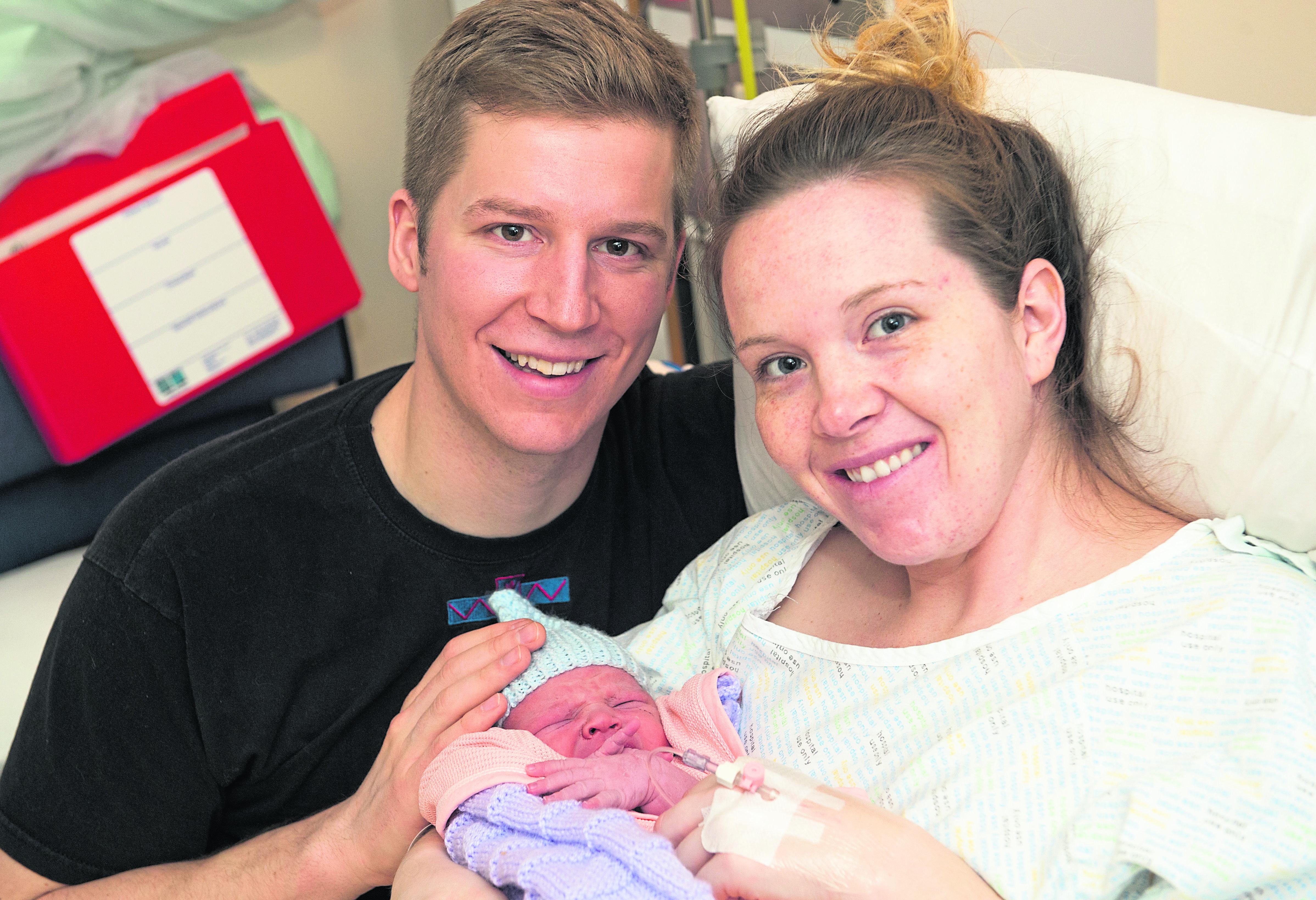 New parents Stephanie Rychlo and RAF Typhoon pilot, Jordan Rychlo and new born son Logan.
