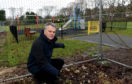 Councillor Martin Ford in front of where the new play park is being built in King Seat