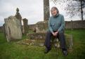 Iona Kielhorn, Chairperson of Lossiemouth Heritage Association at Kinneddar graveyard.