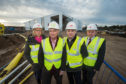 Jane Innes, trustee of Moray Sports Foundation, Sandy Adam, convener of Moray Sports Foundation, Moray MSP Richard Lochhead and Carl Gavine, operations manager of Moray Sports Centre, outside the under construction sports complex in Elgin.