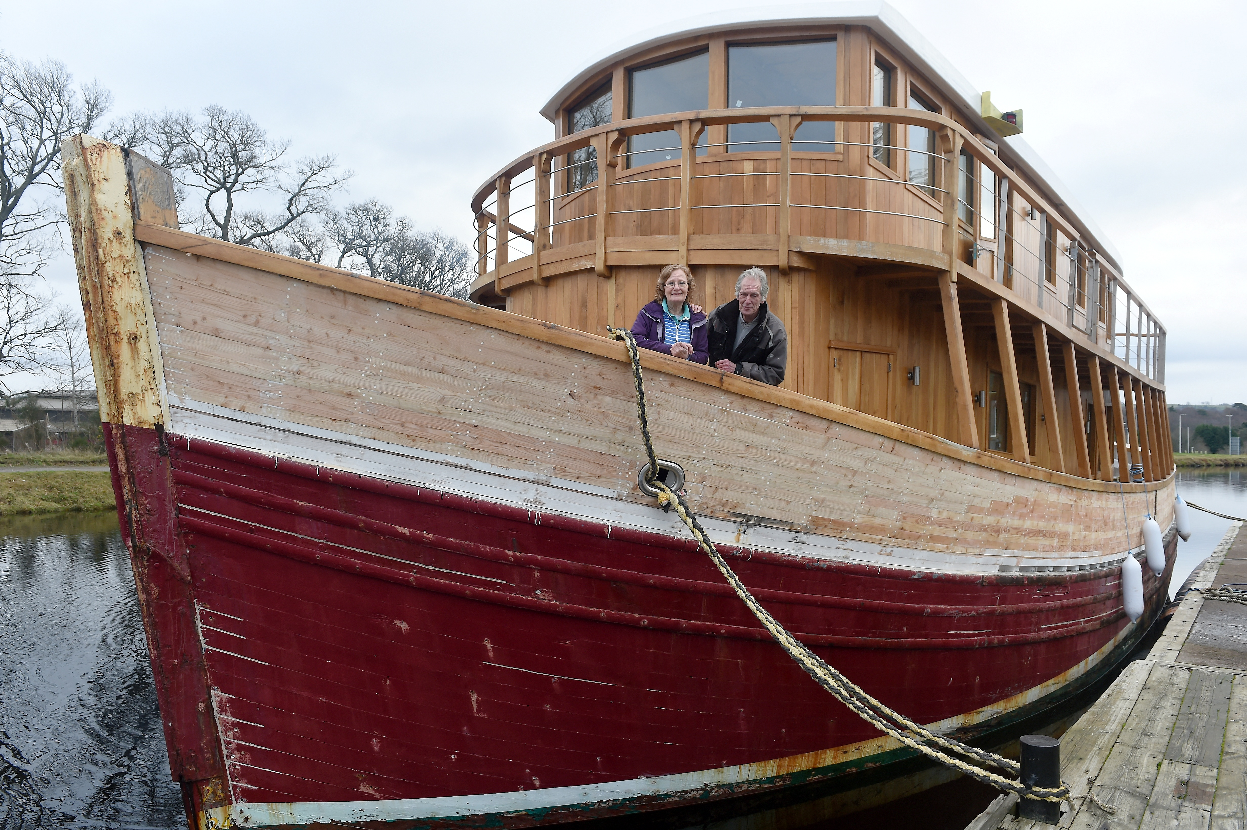 Gaby Monkhouse and her husband Gus Glue with their vessel 'Highland Lassie' on the Caledonian Canal at Inverness.