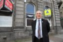 Councillor Brian Topping at the former Clydesdale bank building in Fraserburgh.