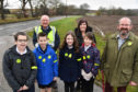 BANFF AND DISTRICT COMMUNITY SAFETY GROUP CHAIRMAN MICHAEL MENARD (L) AND VICE CHAIRMAN MARK FINDLATER WITH KING EDWARD  PRIMARY P7 PUPILS AND HEAD TEACHER AUDREY CLARK DISPLAYING THE RELECTIVE ARMBANDS AND BADGES.