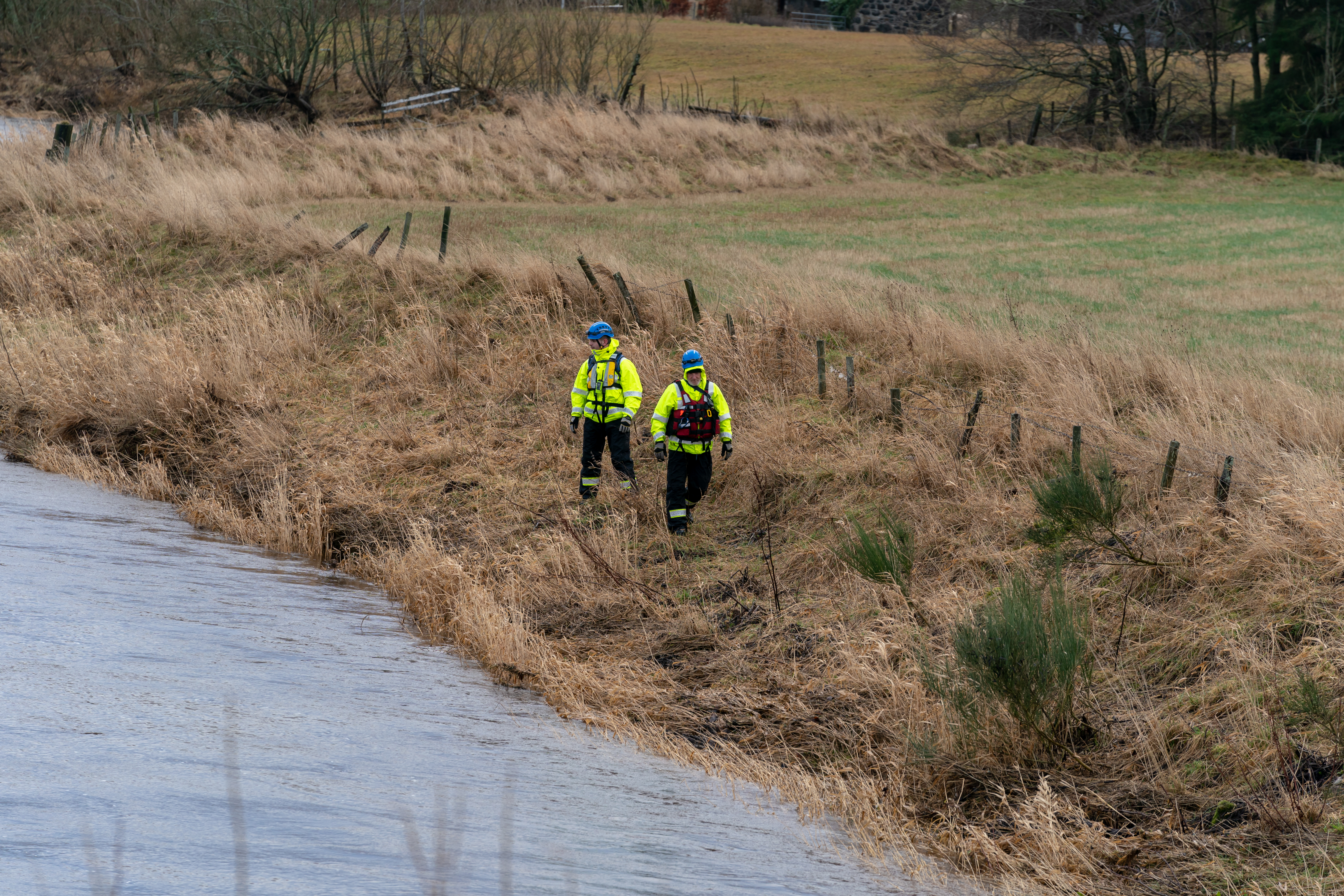 Police and Coastguard teams on the banks of the River Isla in the Keith area of Moray.