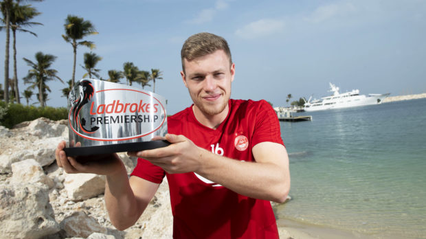 Sam Cosgrove with his trophy for December's player of the month.