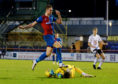 Jordan White (L) is stopped by Ayr United keeper Ross Doohan.