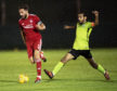 Aberdeen's Graeme Shinnie (left) and Abdulhameed Al-Nemri in action