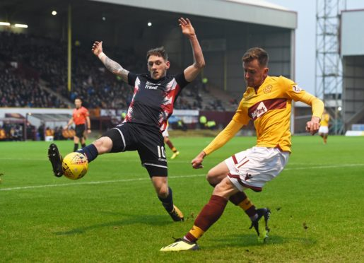 Motherwell's Elliott Frear (right) sees his cross blocked by Declan McManus