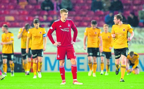 Aberdeen's Lewis Ferguson looks dejected after Stenhousemuir's equaliser.