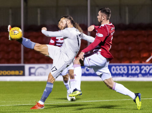 Aberdeen's Stevie May competes with Scott McMann