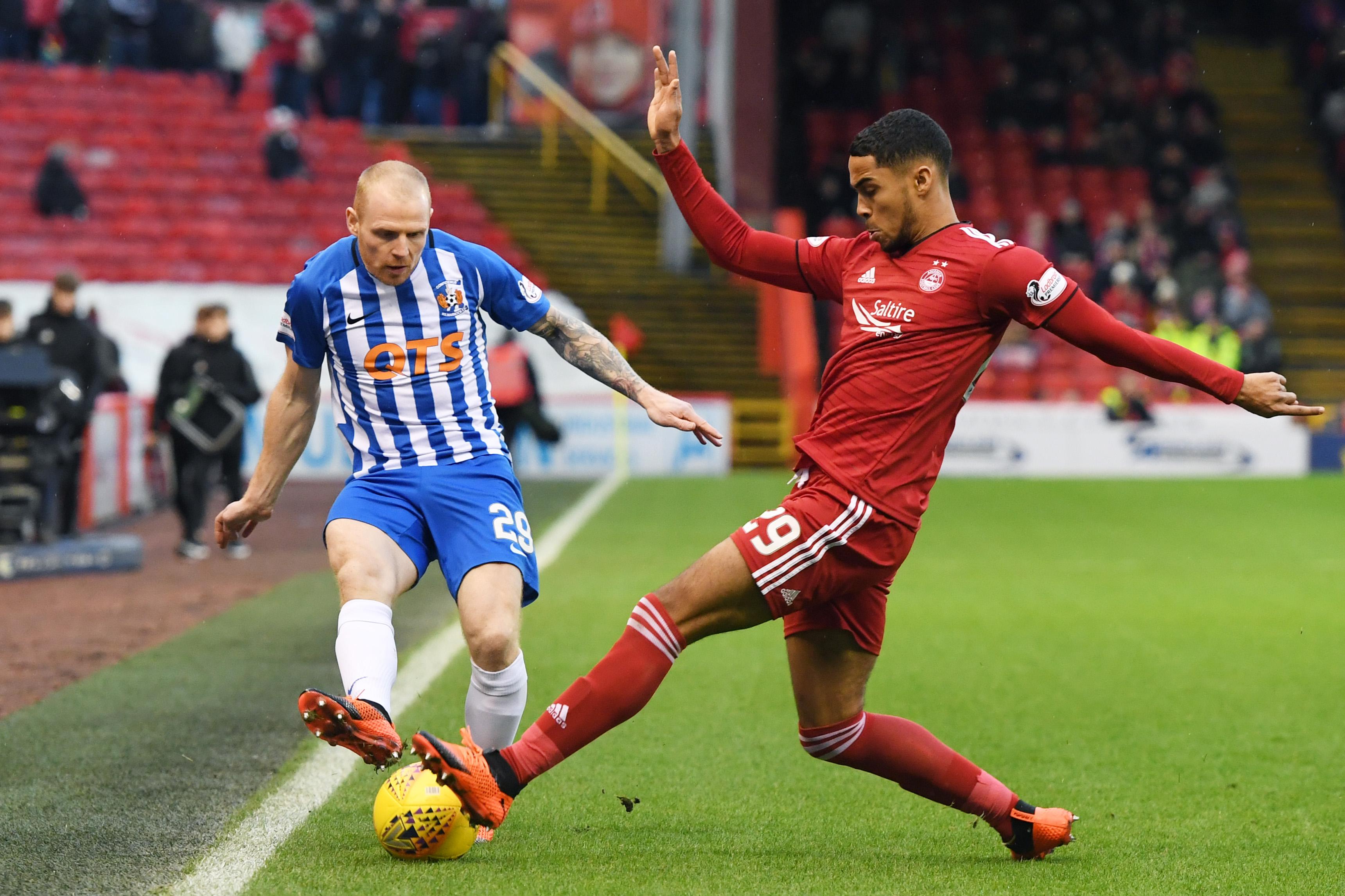 Aberdeen's Max Lowe challenges Chris Burke