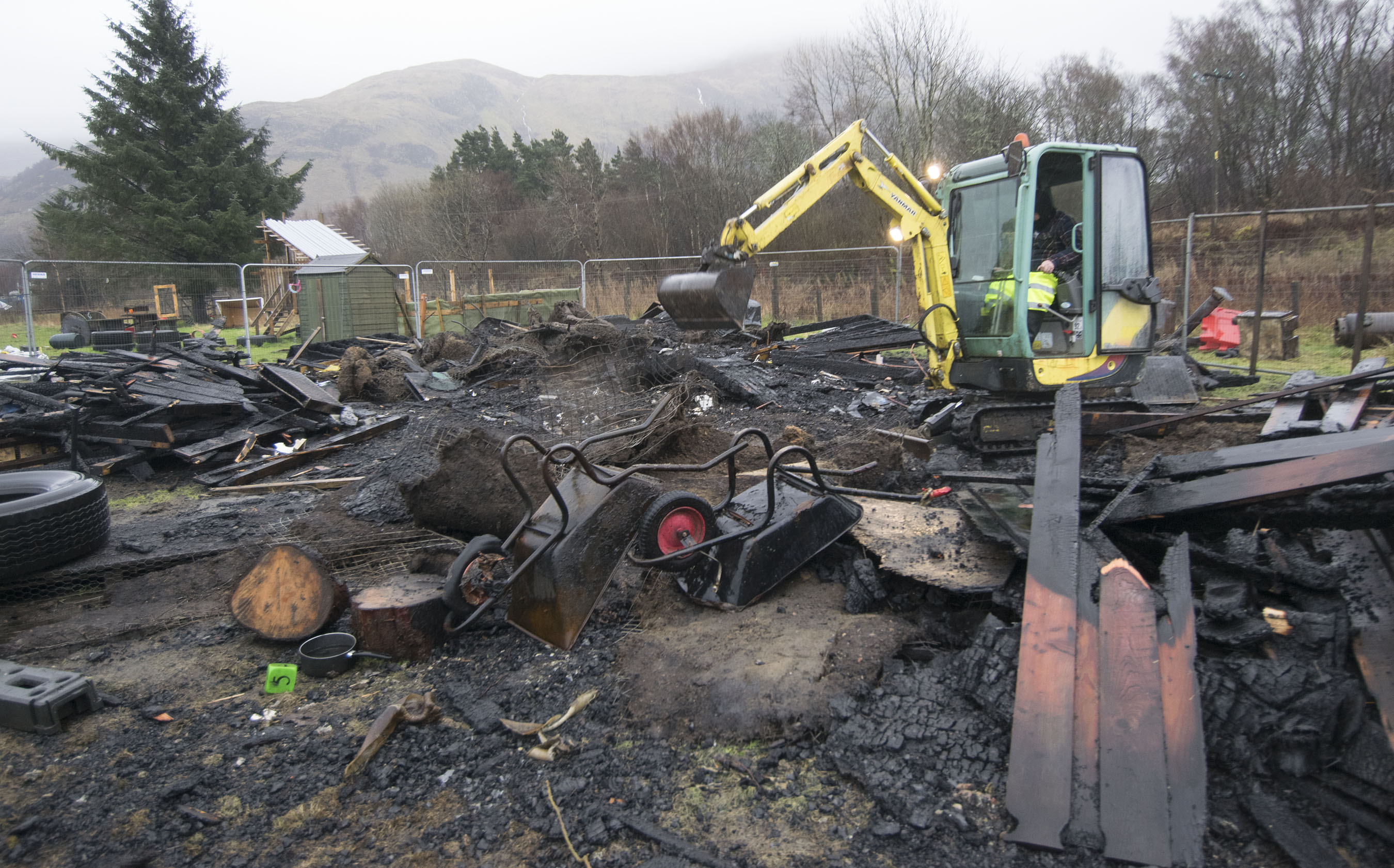 Local businesses provided heavy equipment to help clear away the remains of fire damaged buildings.