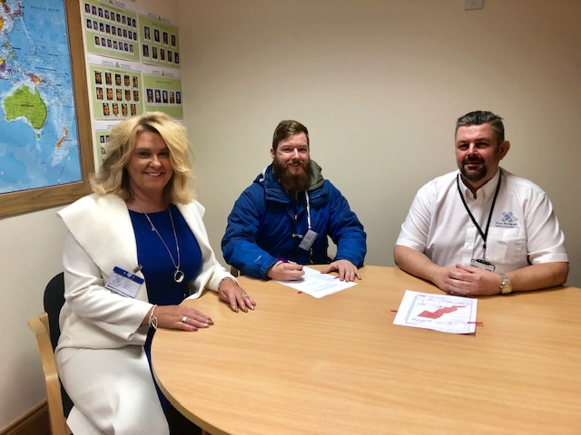 Dianne Beagrie and Lewis Swales from Brave Outdoors sign the new lease agreement with Conrad Ritchie from Score.