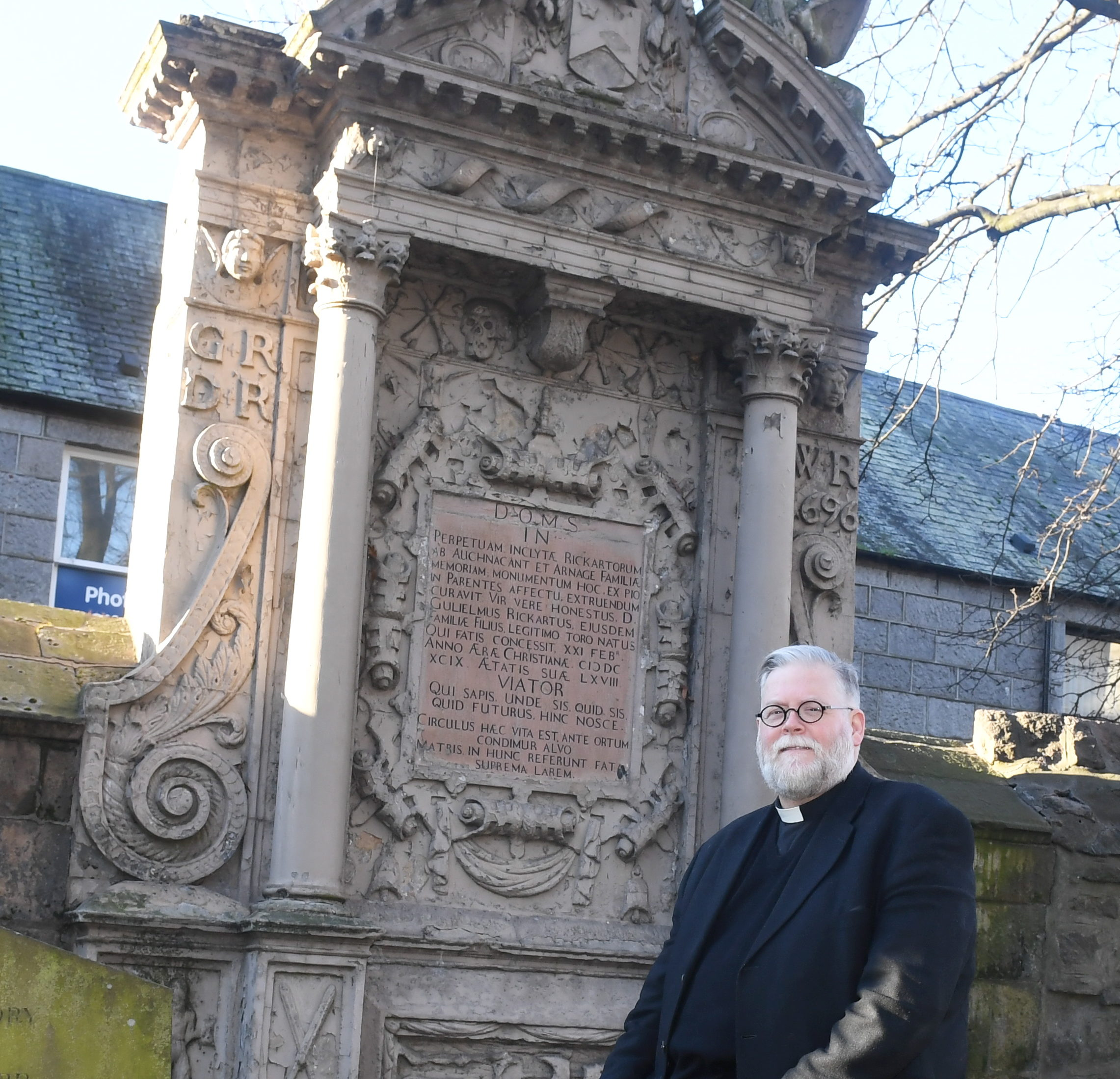 The Reverand Stephen Taylor is pictured with the Rickart's Memorial in St Nicholas Kirkyard before work on it's restoration begins.