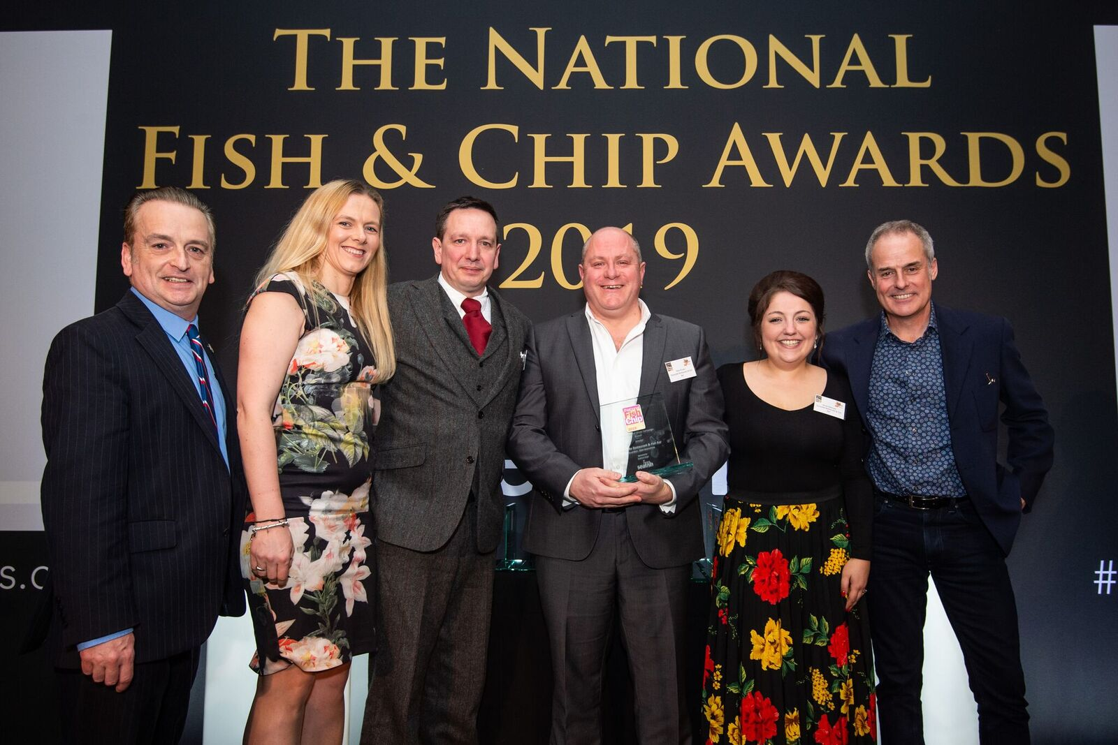 The team from the Quayside pick up their award.