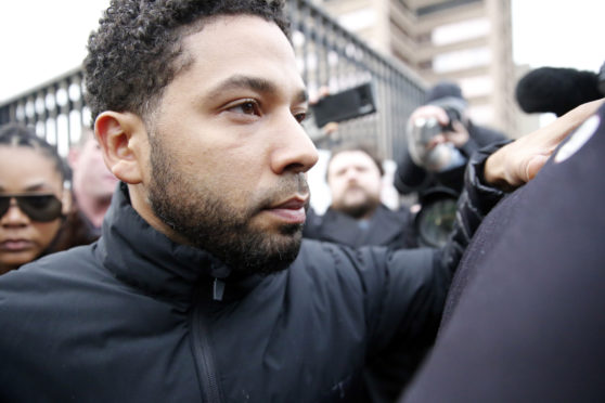 FILE - Actor Jussie Smollett Suspended From US TV Series Empire CHICAGO, ILLINOIS - FEBRUARY 21: Empire actor Jussie Smollett leaves Cook County jail after posting bond on February 21, 2019 in Chicago, Illinois.  Smollett has been accused with arranging a homophobic, racist attack against himself in an attempt to raise his profile because he was dissatisfied with his salary.  (Photo by Nuccio DiNuzzo/Getty Images)