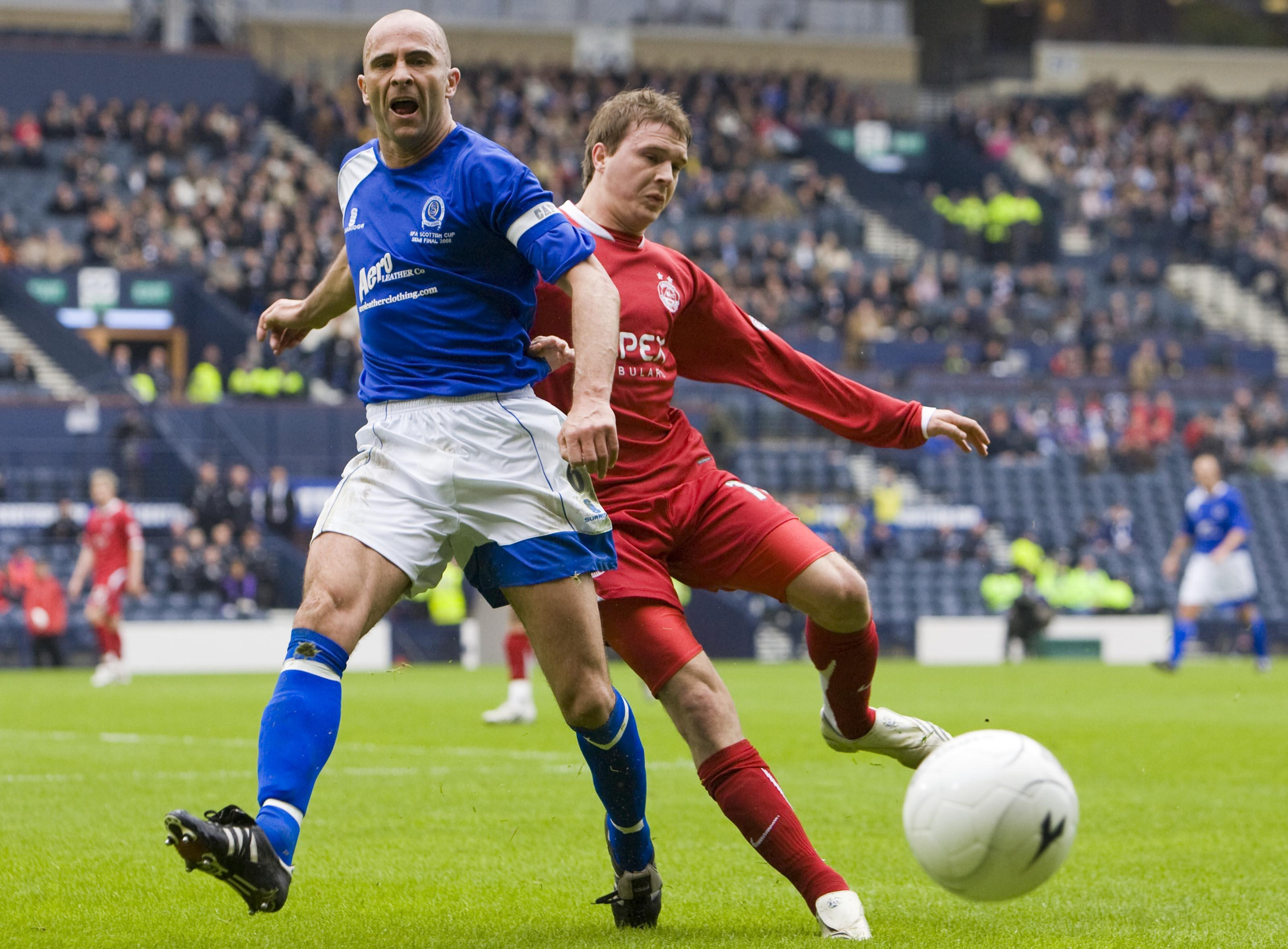 Queen of the South's Jim Thomson battles with Aberdeen's Darren Mackie.