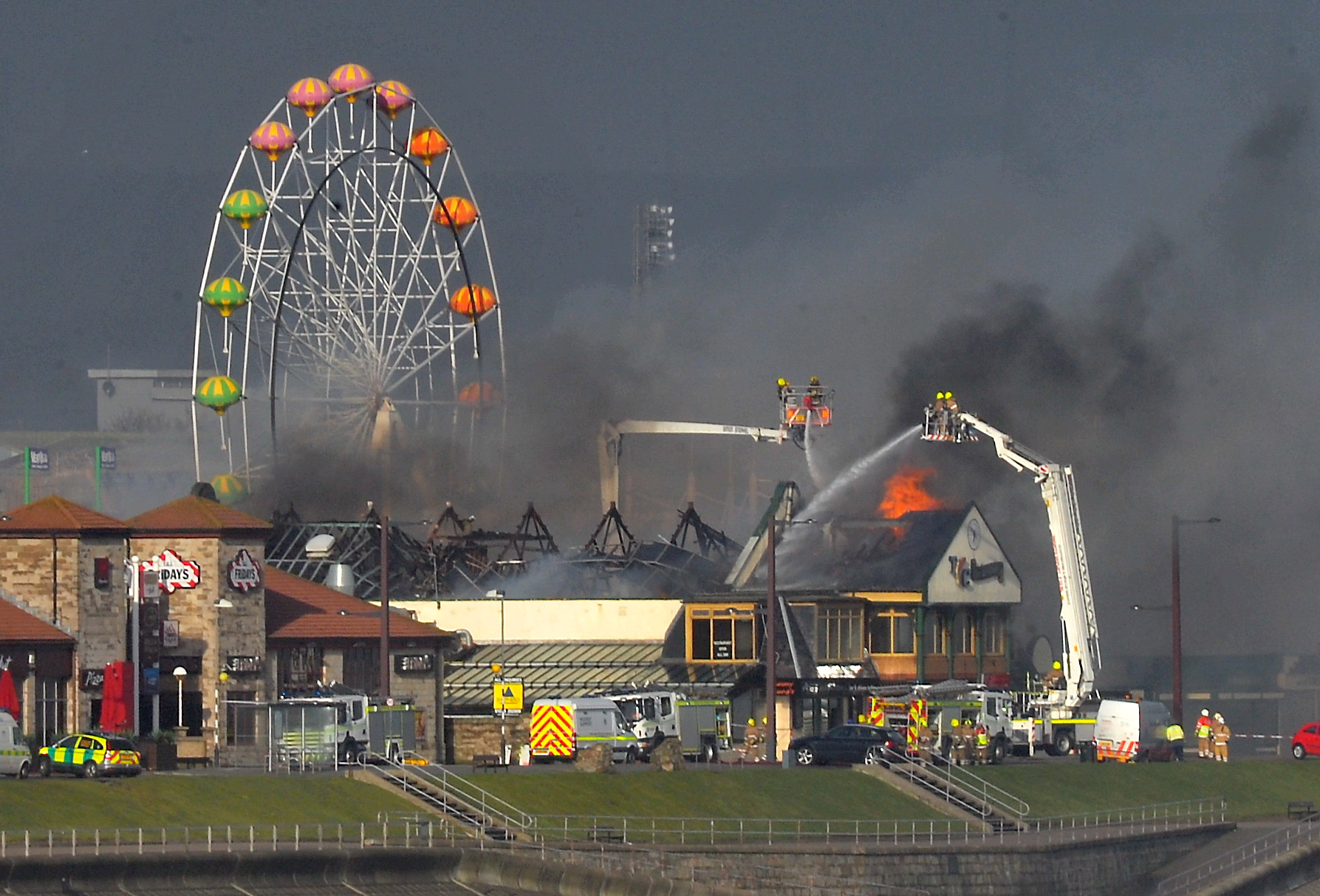 Aberdeen Beach engulfed by smoke after Jimmy Chungs restaurant on the beach front caught fire.