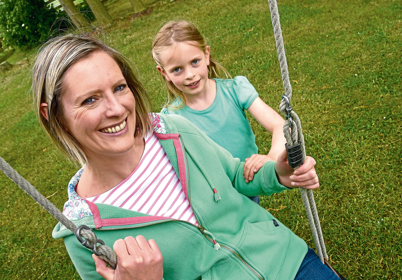 Jo Mackenzie and her daughter Daisy.                                                Jo with Daisy (7).