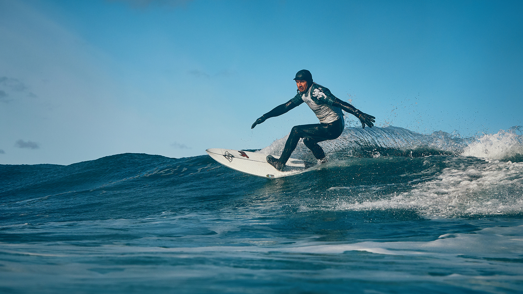 Craig Sutherland, 2018 Masters Champion, is pictured catching a wave.