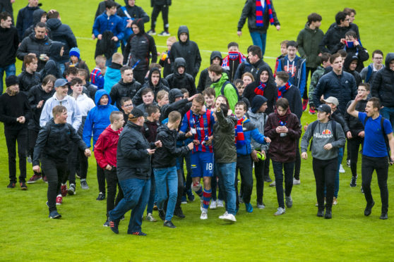 Alex Fisher is mobbed by Caley Thistle fans after their relegation.