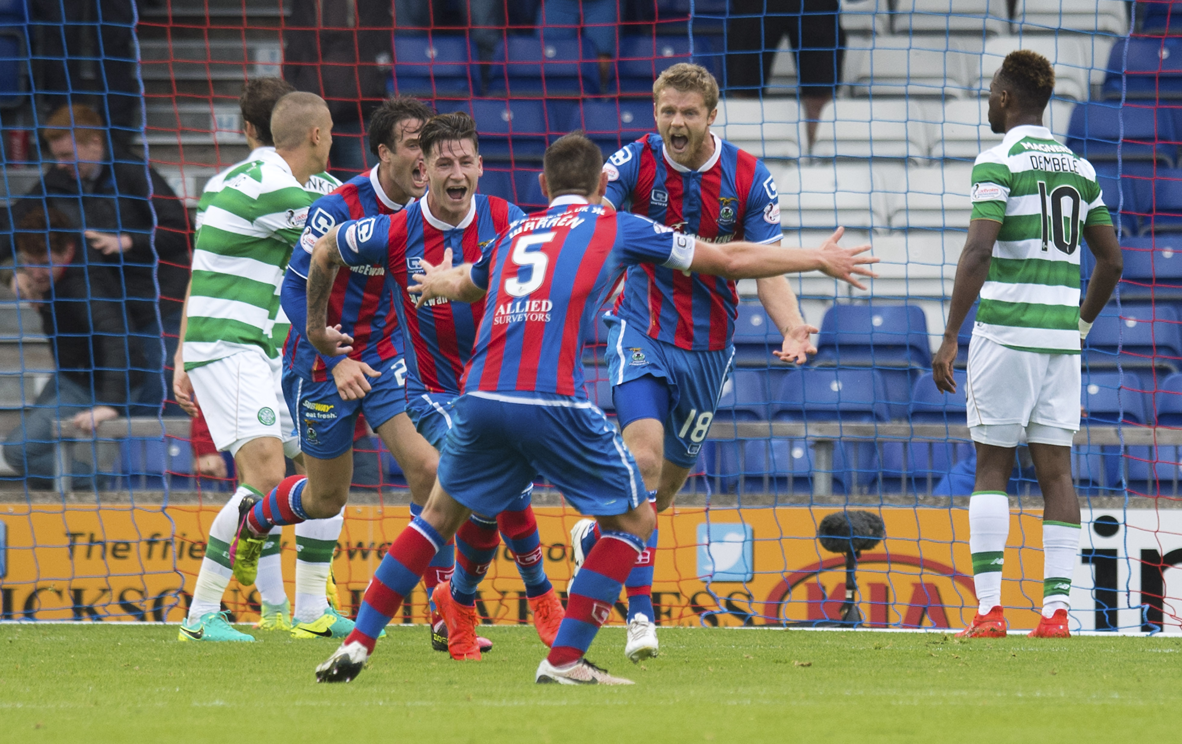 Alex Fisher runs to Gary Warren after his equaliser against Celtic in August 2016.